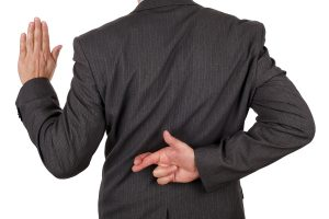 bigstock-Swearing-an-oath-with-fingers-39094954
